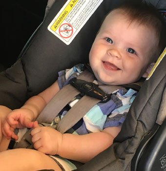 Smiling child in a car seat